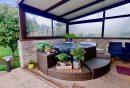 Maison de plain-pied située dans une zone pavillonnaire édifiée sur un terrain de 534m2 avec terrasse et jacuzzi