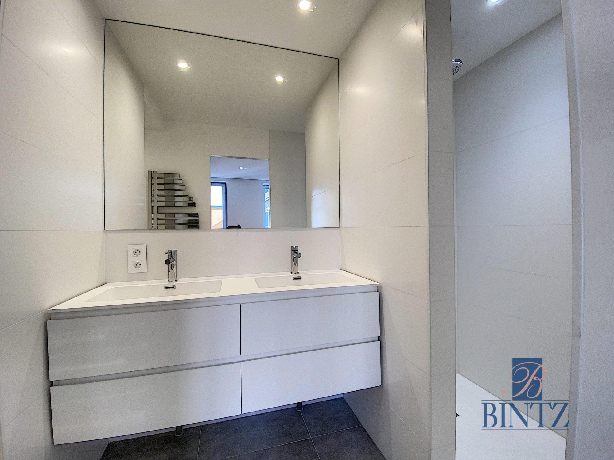 5 pièces d'exception face à la mairie - Devenez locataire en toute sérénité - Bintz Immobilier - 6