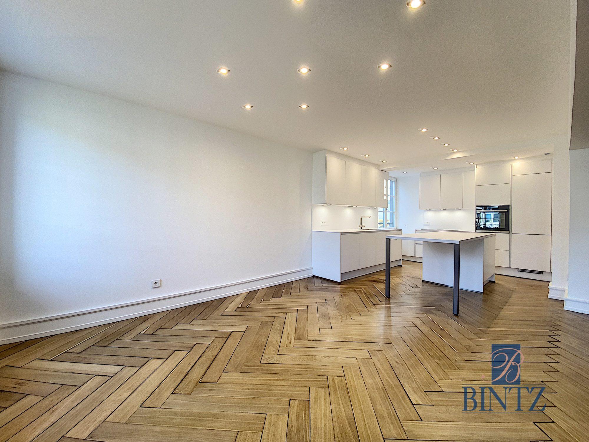 5 pièces d'exception face à la mairie - Devenez locataire en toute sérénité - Bintz Immobilier - 14