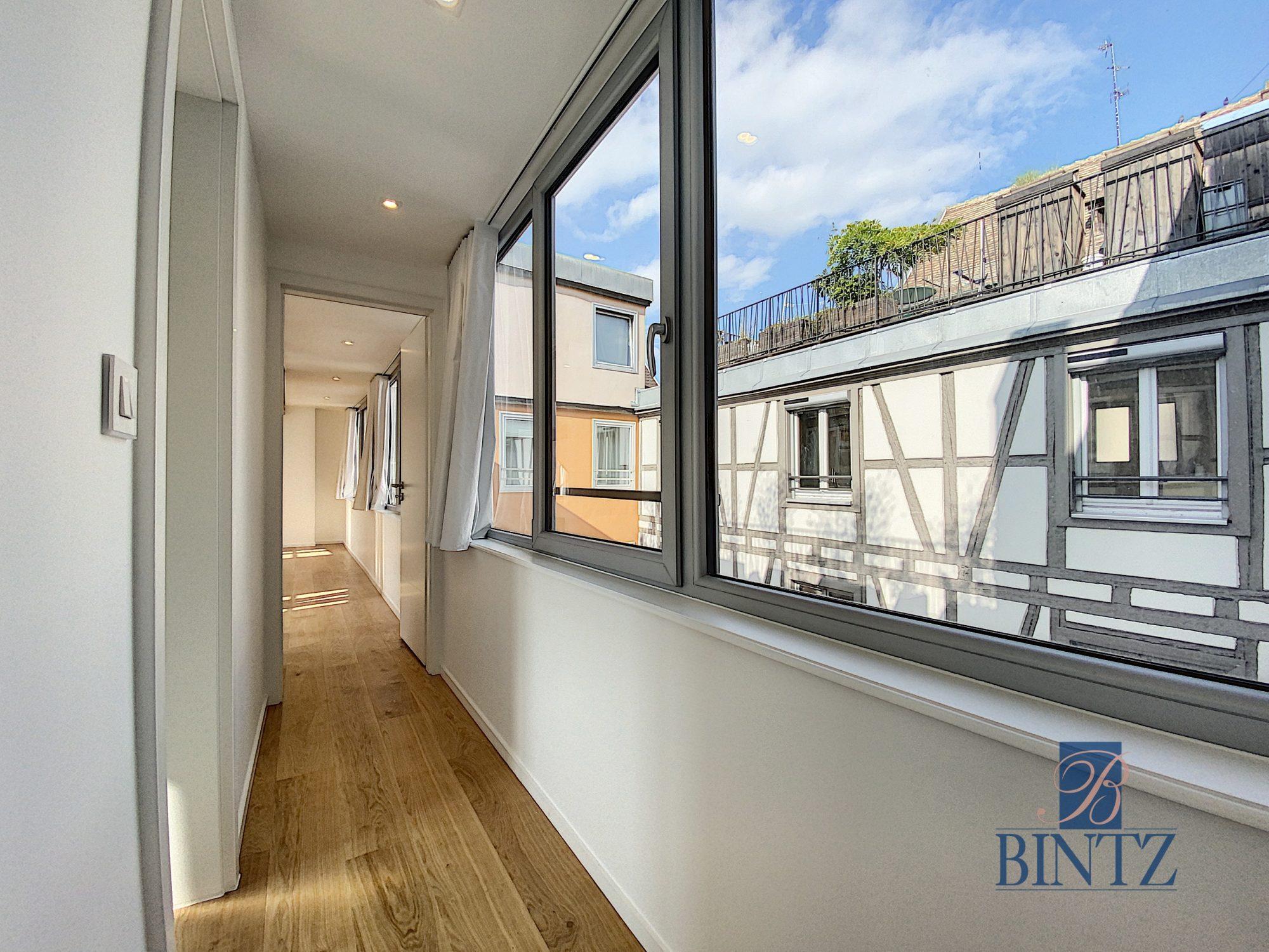 5 pièces d'exception face à la mairie - Devenez locataire en toute sérénité - Bintz Immobilier - 15