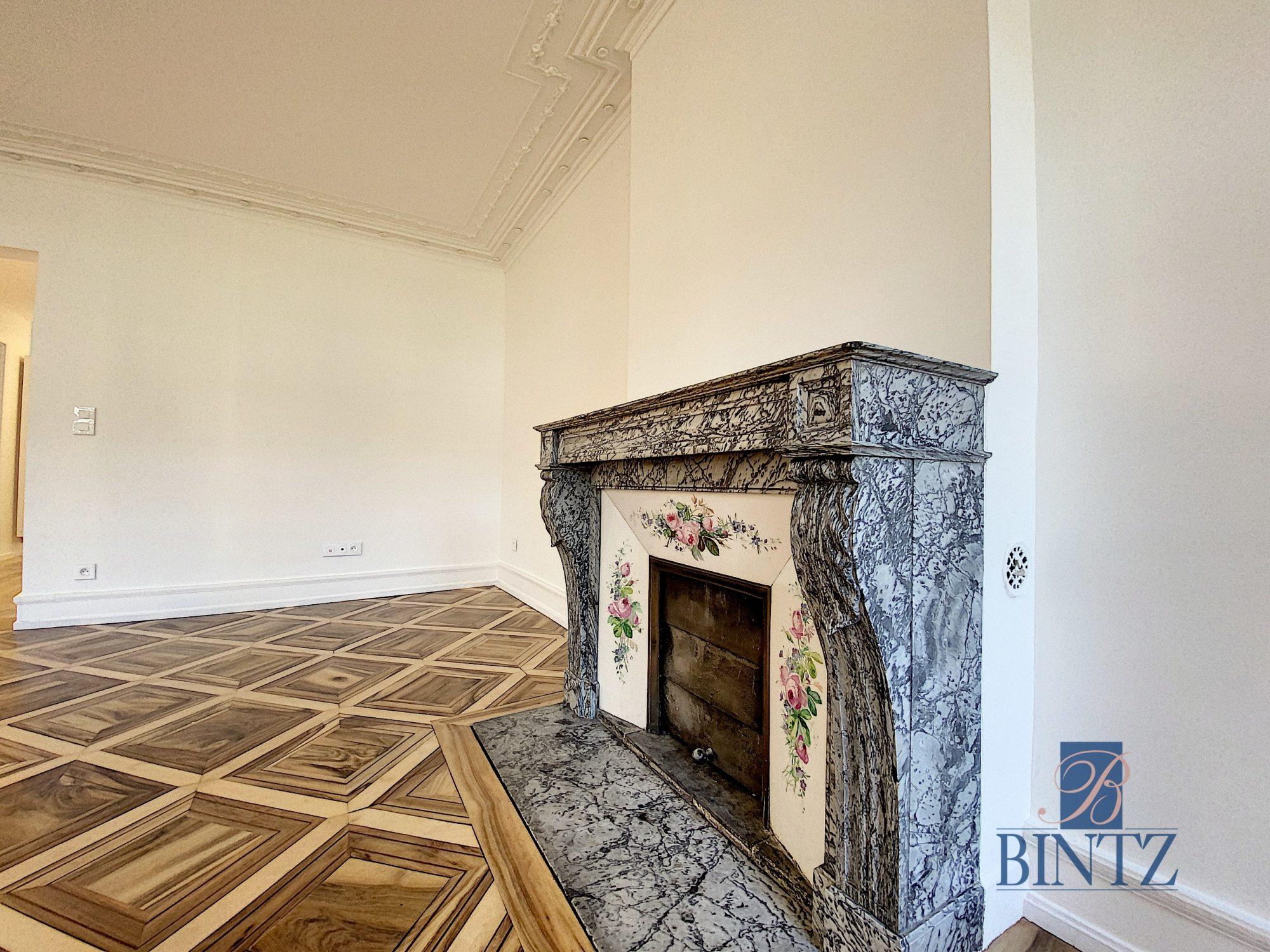 5 pièces d'exception face à la mairie - Devenez locataire en toute sérénité - Bintz Immobilier - 18