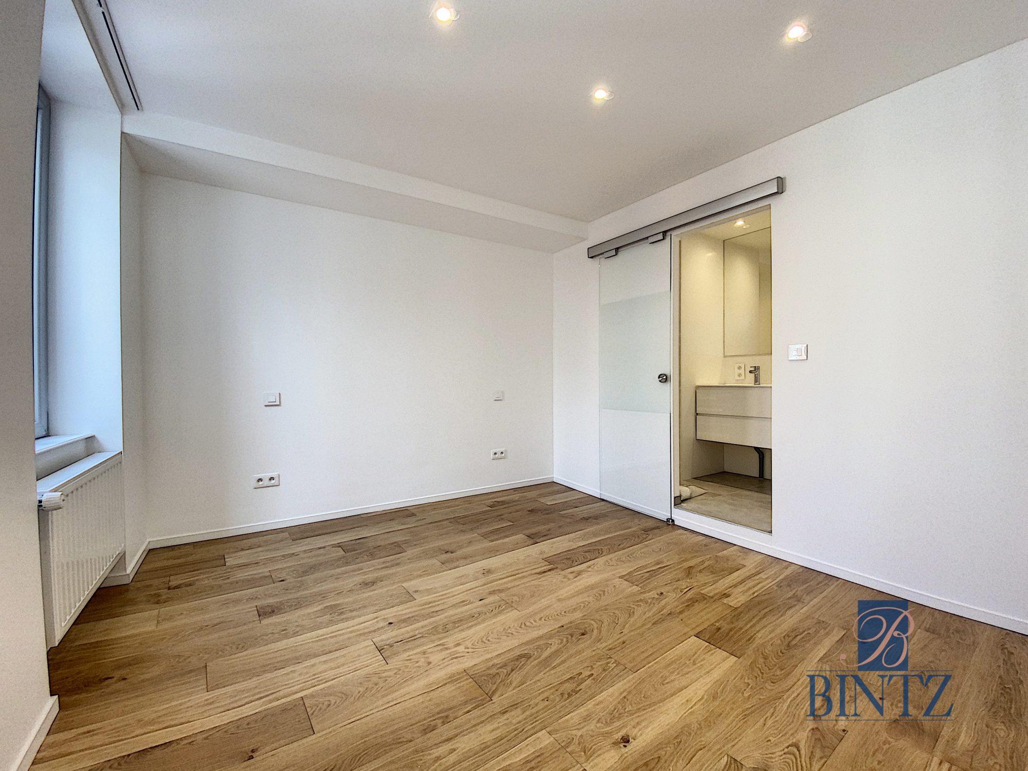 5 pièces d'exception face à la mairie - Devenez locataire en toute sérénité - Bintz Immobilier - 19