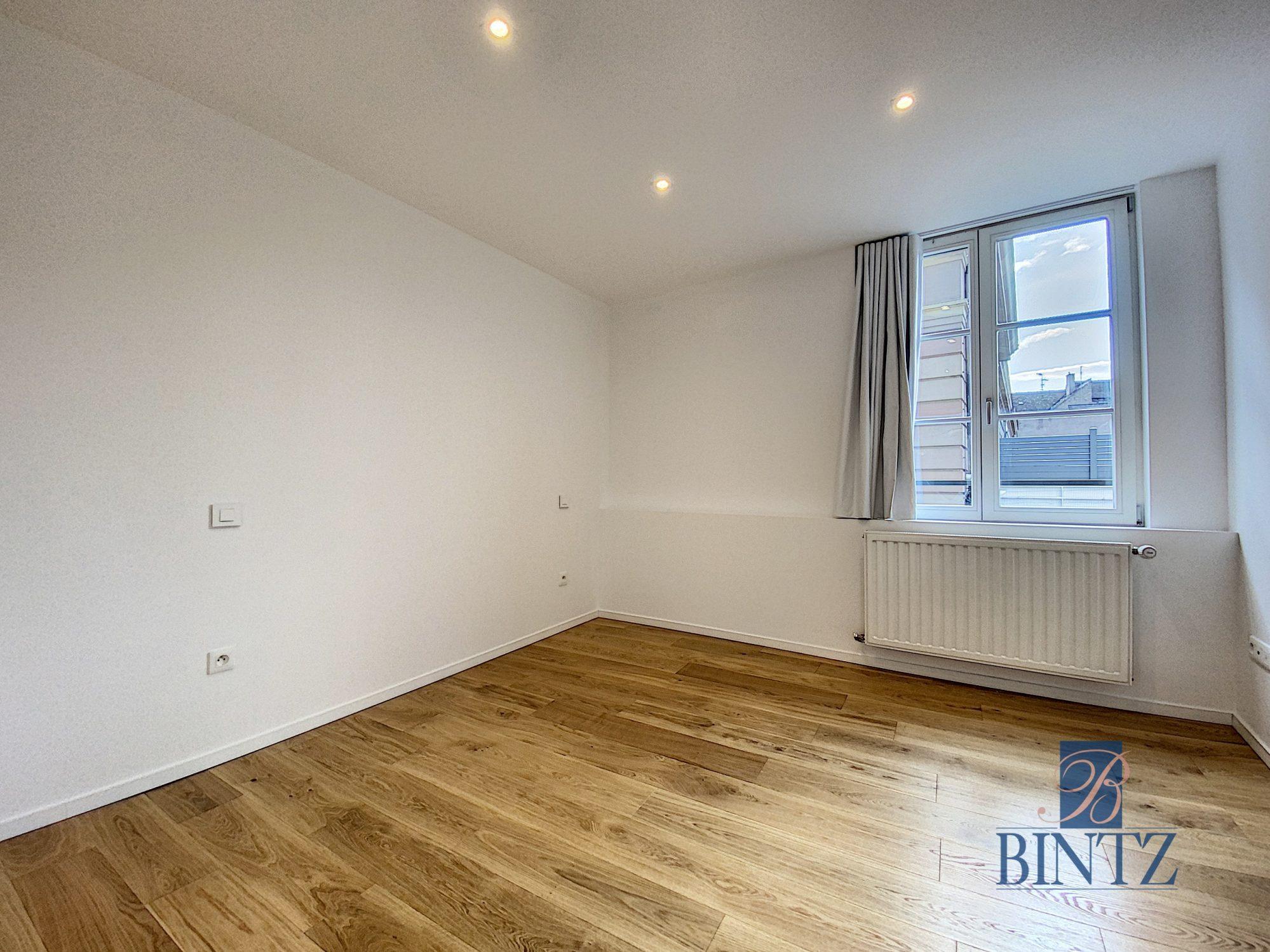 5 pièces d'exception face à la mairie - Devenez locataire en toute sérénité - Bintz Immobilier - 20