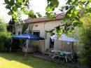 Maison   7 pièces 125 m²