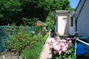 Maison de plain-pied rénovée et joli jardinet.