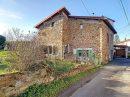 Maison en pierre, 4 pièces, sur une parcelle de 450m2 à Bourg les Thizy avec garage.