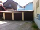 T 2 avec garage et petit terrain