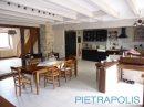 Maison   11 pièces 229 m²