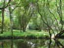 MOULIN du 17ème siècle sur 7 hectares de prés, de bois.