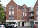Centre ville Appartement 2 chambres, balcon, cave et garage