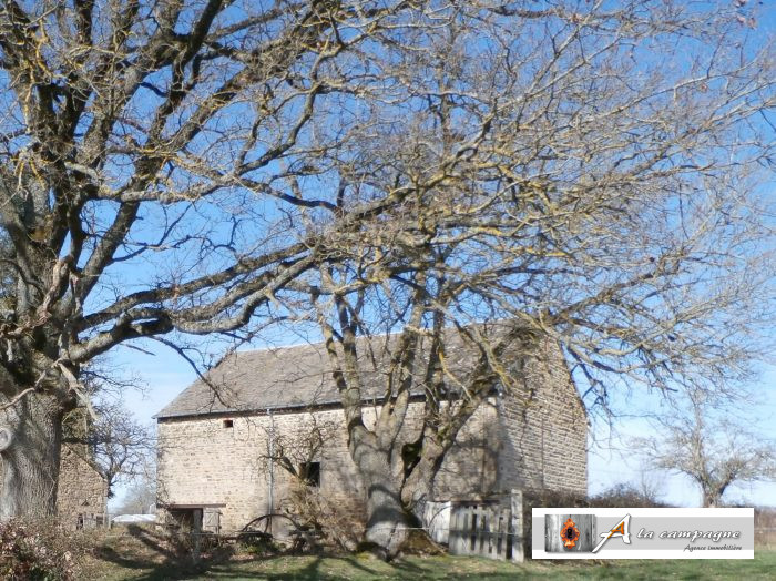 Stone barn with attached land.