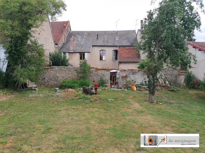 Large village house with enclosed courtyard and garden.