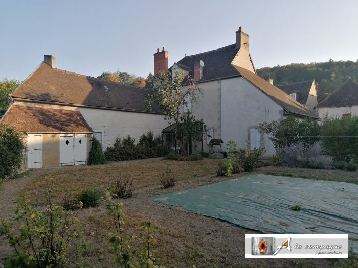 Grand house with garden in a beautiful village with two rivers.