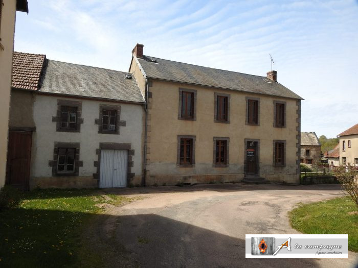 Large house with garden and barn in picturesque village