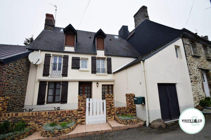photo de Maison de bourg avec cave, garage et jardin